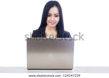 Successful business woman in office work place typing laptop computer keyboard on a white background