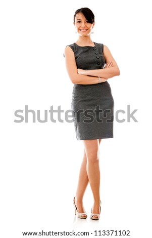Successful business woman with arms crossed - isolated over a white background