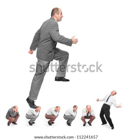 Successful businessman. Conceptual image - business rivalry metaphor.