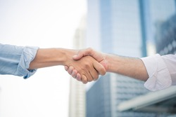 Successful businessman handshaking after good deal in the city. Business partnership concept. Shaking hands.