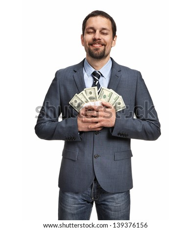 Successful businessman holding money - isolated over a white background