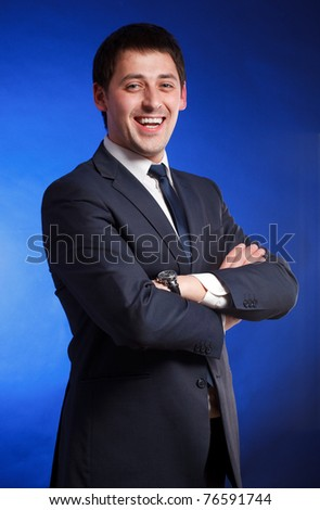 Successful businessman over blue background