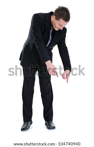 Successful businessman pointing down isolated