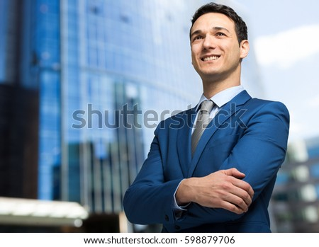 Successful businessman portrait outdoor in a modern city #598879706