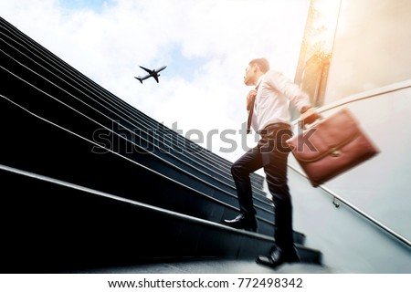 Successful businessman  running fast upstairs Success concept #772498342