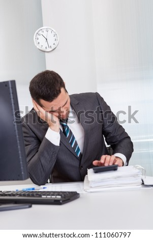 Successful businessman sleeping at desk it the office