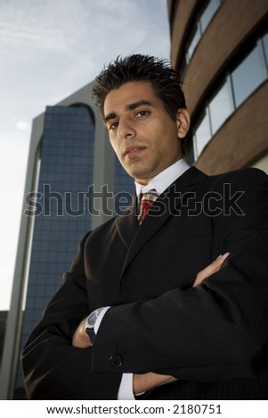successful businessman staring at the sky a bit worried