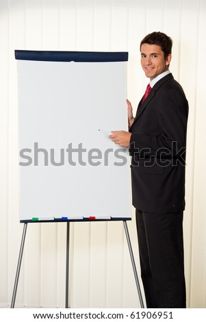 Successful businessman with a flip chart in a presentation