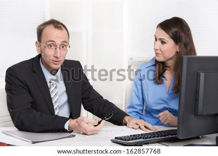 Successful businessman with suit and tie have a problem with his female colleague