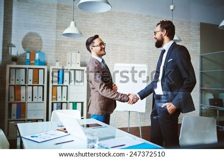 Successful businessmen handshaking after negotiation
