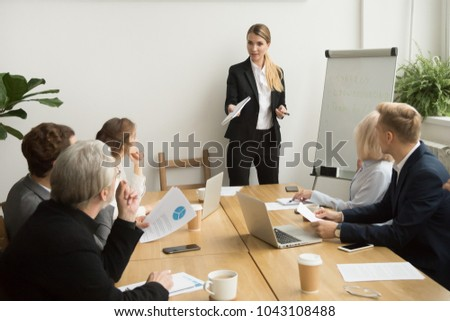 Successful businesswoman giving presentation to business team, female ceo leader coaching teaching on corporate training, woman boss talking planning explaining answering questions at group meeting