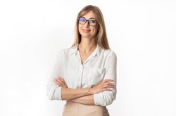 Successful Businesswoman. Positive Lady Smiling At Camera Standing Crossing Hands On White Studio Background. Isolated