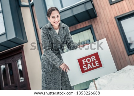 Successful businesswoman. Successful businesswoman feeling excited while selling her house in the city #1353226688