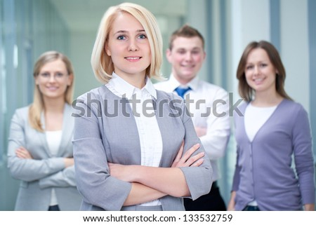 Successful businesswoman with colleagues in the background