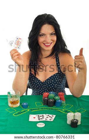 Successful casino woman holding goood cards and giving thumb up against white background - stock photo