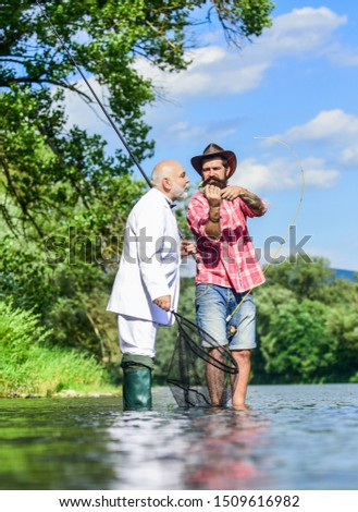 Successful catch. Elegant bearded man and brutal hipster fishing. Hobby and recreation. Family day. Fishing team. Relax in natural environment. Summer vacation. Friends fishing. Perfect weekend. #1509616982