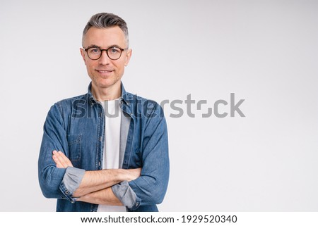 Successful caucasian middle-aged man in casual outfit with arms crossed isolated over white background