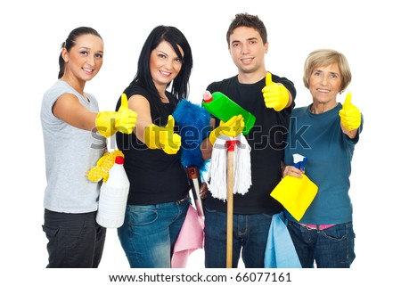 Successful cleaning people teamwork giving thumbs up and holding products for clean house