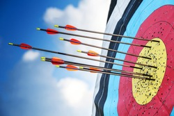 Successful concept, all gold arrows on target, archery sport.
