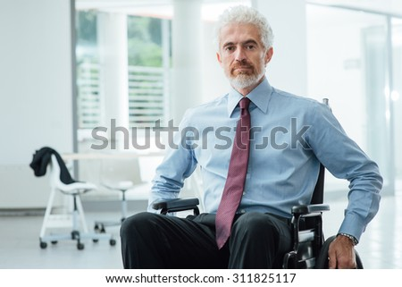 Successful confident businessman in wheelchair smiling at camera, career and disability overcoming concept
