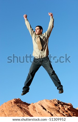 Successful confident businessman jumping with happiness