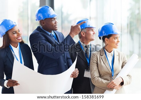 successful construction team discussing architectural project