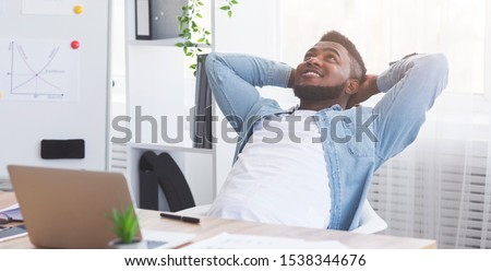 Successful deal. Satisfied african american office worker leaning on chair with hands behind head, relaxing after completed job, panorama