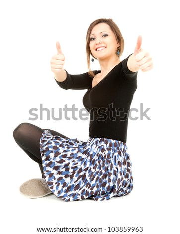 successful elegant young woman with thumbs up, full length, white background