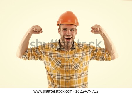 Successful engineer. Strong handsome builder. Man protective helmet and uniform white background. Worker builder confident and successful. Protective equipment concept. Builder enjoy success.