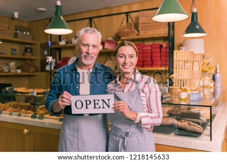 Successful entrepreneurs. Couple of successful entrepreneurs feeling happy opening their first French bakery