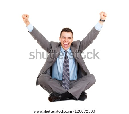 Successful excited businessman happy smile hold fist ok yes gesture, business man sitting in yoga lotus pose on floor with raised hands arms, full length isolated over white background