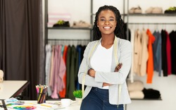 Successful Fashion Business. Smiling Black Designer Posing In Own Dressmaking Studio Or Boutique. Free Space