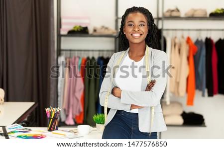 Successful Fashion Business. Smiling Black Designer Posing In Own Dressmaking Studio Or Boutique. Free Space Foto d'archivio ©