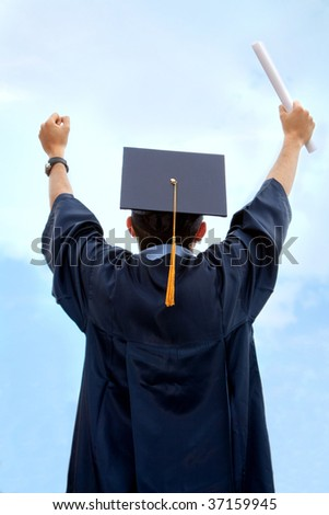Successful graduate man with a diploma outdoors