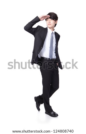 Successful handsome business man purposefully looking away to empty copy space in full length isolated on white background, mode is a asian male