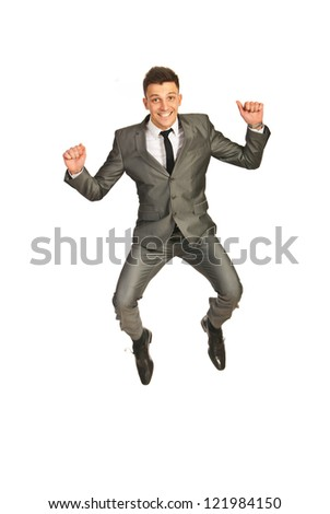 Successful happy business man leaping isolated  on white background