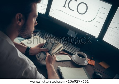Successful investor holding cash making money with initial coin offering, rich stock trader broker earned high profit from cryptocurrency investment, token sale exchange and ico participation concept