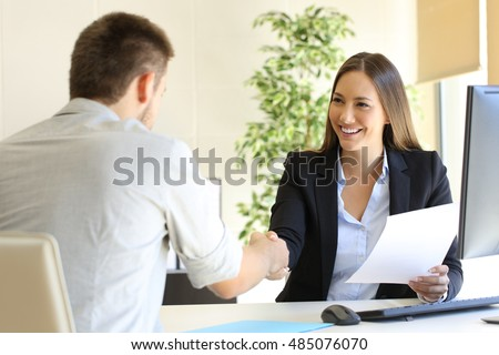 Successful job interview with boss and employee handshaking Foto d'archivio ©
