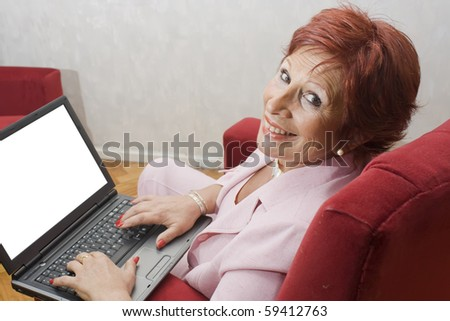 Successful lady with laptop with blank space in the monitor free for write. with clipping path in monitor