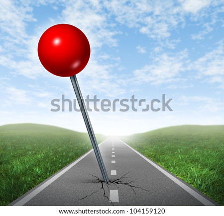 Successful location direction business symbol with a red push pin pinned and marked on a perspective oriented asphalt road  as an icon of vision and achieving your goals.