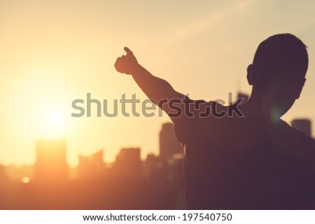 Shutterstock Successful Man aiming at Sunset
