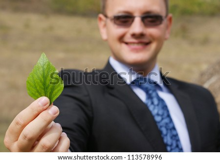 successful man with a green leaf.