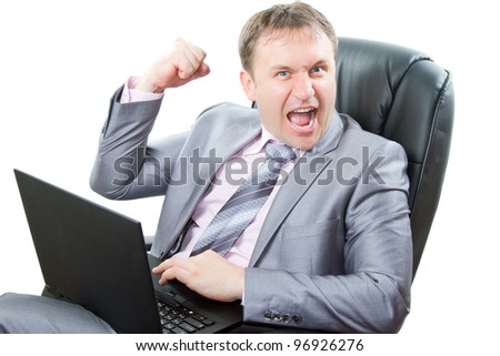 successful man with laptop showing thumbs and cry on white background.