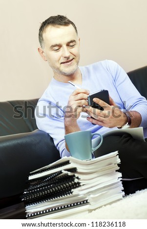 Successful man working on the smartphone.