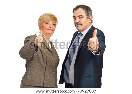 Successful mature business people team giving thumbs up isolated on white background