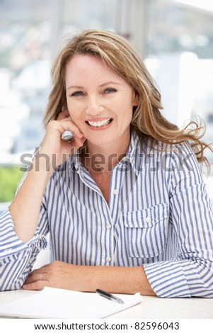 Successful mid age businesswoman on phone