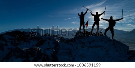 successful mountaineers silhouette #1006591159