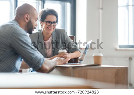 Successful professionals looking through online ideas for their business project - Shutterstock ID 720924823
