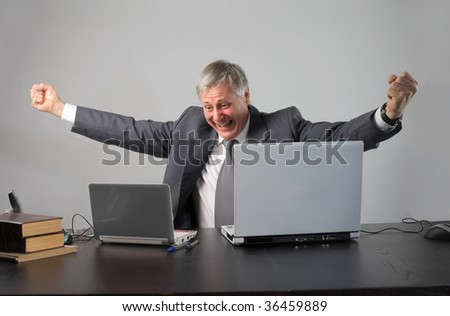 successful senior businessman with laptop