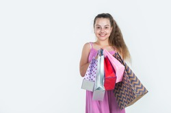 Successful shopping. kid on cyber monday. big sale. teen girl hold paper bags. buy gifts and presents for holiday. shopaholic kid with purchase packages. happy child go shopping. black friday concept.